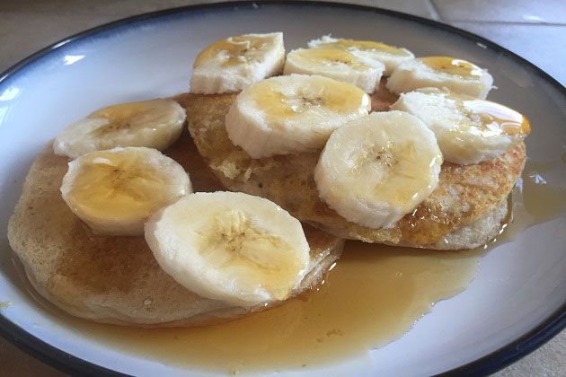 Flap Jacked pancakes with bananas and syrup