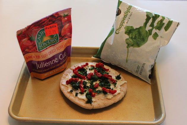 Sun-dried tomatoes and chopped spinach pizza toppings